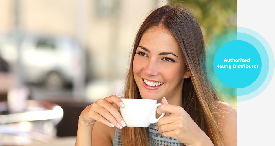 Woman drinking a cup of hot coffee at work